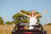 Attractive young loving couple is traveling by car — Stock Photo