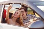 Beautiful loving couple is photographing themselves in transport — Stock Photo