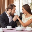 Beautiful young loving couple is dating in cafe — Stock Photo #83518460