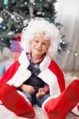 Cute small male child near Christmas tree — Stock Photo