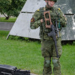 Постер, плакат: Marines in Russia camouflage and with weapons guarding a military facility
