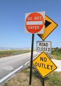 Warning Signs on Lonely Road — Stock Photo