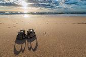 Flip-flops on the beach — Stock Photo