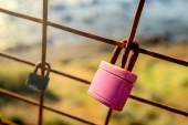 Rusty love locks hanging on the fence as a symbol of loyalty and — Stock Photo