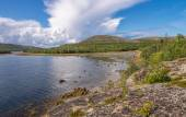 Landscape coastline of the island Kuzov, blue sky, clouds. — Stock Photo