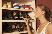 Beautiful woman chosing shoes — Stock Photo