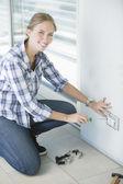 Woman using screwdriver — Stock Photo