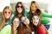 Friends in funny glasses having party — Stock Photo