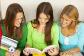 Girl with friends reading — Stock Photo