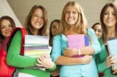 Girls hålla böcker — Stockfoto