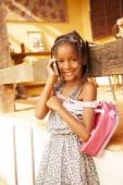 Girl using mobile phone — Stock Photo