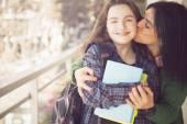Mother kissing  girl — Stock Photo
