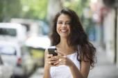 Woman holding phone — Foto de Stock