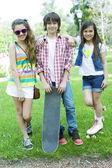 Girls and boy posing — Foto Stock