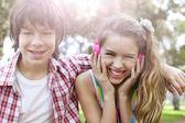 Happy boy and girl having fun — Stock Photo