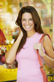 Woman standing near shop — Stock Photo