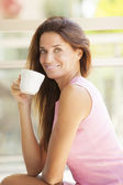 Mature woman holding cup — Stock Photo
