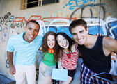 Friends posing outdoors — Stock Photo