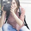 Young woman holding camera — Stock Photo #73271877