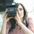 Young woman holding camera — Stock Photo #73271993
