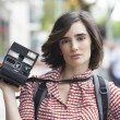 Young woman holding camera — Stock Photo #73272059