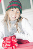 Teen girl with christmas present — Stock Photo