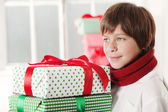 Boy holding Christmas Gifts — Stock Photo