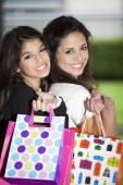 Women holding shopping bags — Stock Photo