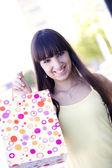 Girl holding shopping bag — Stock Photo