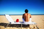 Man sitting on beach — Stock Photo