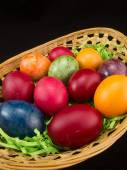 Multicolor easter eggs in basket — Stock Photo