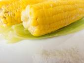 Boiled fresh ripe corn with salt on a plate — Stock Photo