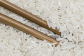 Chopsticks submerged in rice — Stock Photo