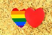 Rainbow Red heart and the LGBT gay pride flag — Stock Photo