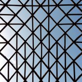 Geometric unusual structure with crossed wooden bars — Stock Photo