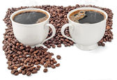 Cups of coffee with coffee beans — Stock Photo