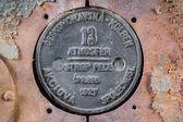Old round locomotive plate — Stock Photo