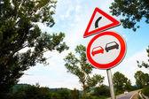 No overtake and three-cornered right turn sign — Stock Photo