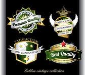 Vintage golden black premium quality labels — Stock Vector