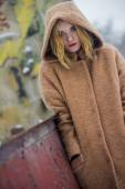 The girl in the coat on the street  — Stock Photo
