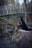Girl with a lantern at the river — Stock Photo