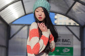 Portrait of stylish Asian girls near small cart — Стоковое фото