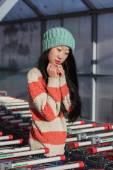 Portrait of stylish Asian girls near small cart — Stok fotoğraf
