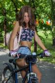 Sexy cute girl on sports bike in the city — Stock Photo