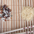 Two slides rice and Chinese sticks on the Mat — Stock Photo #64876011
