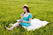 Pregnant woman in the field — Stock Photo