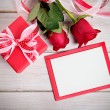 Valentine background of gift box, two red roses and blank card w — Stock Photo #63949571