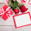 Valentine background of gift box, two red roses and blank card w — Stock Photo #63949579