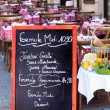 Menu board of French restaurant — Stock Photo #65056189