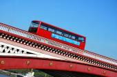 Red double decker bus on Blackfriars bridge in London — Stock Photo